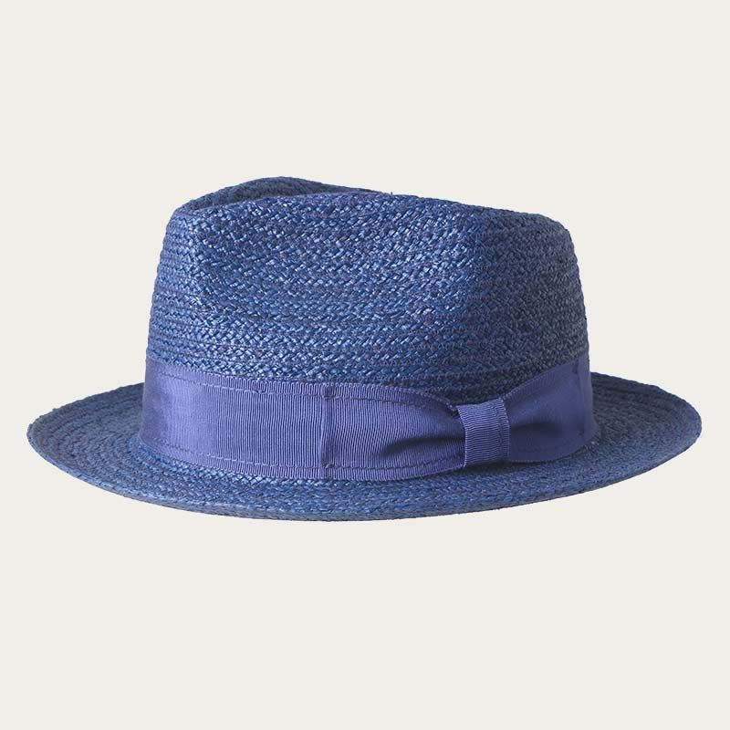 oblique view of short brim blue straw fedora hat with blue bowknot