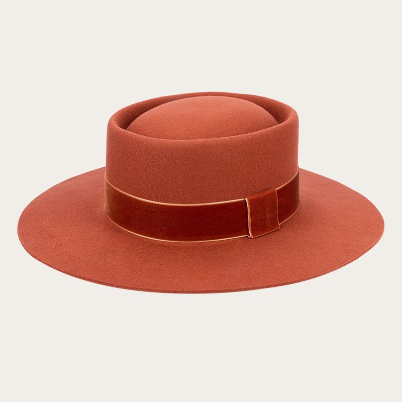 oblique view of orange fedora with wide ribbon