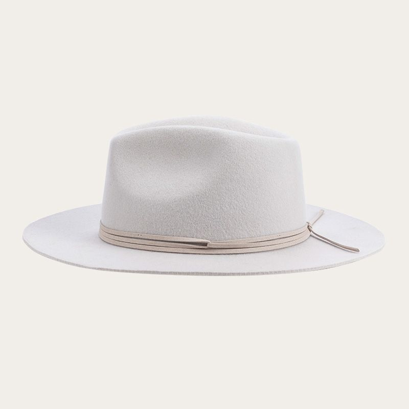 side view of all white fedora hat with decorative ribbon