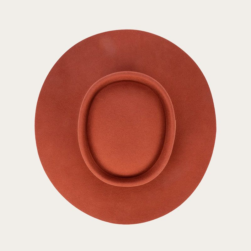 top view of orange fedora with wide ribbon