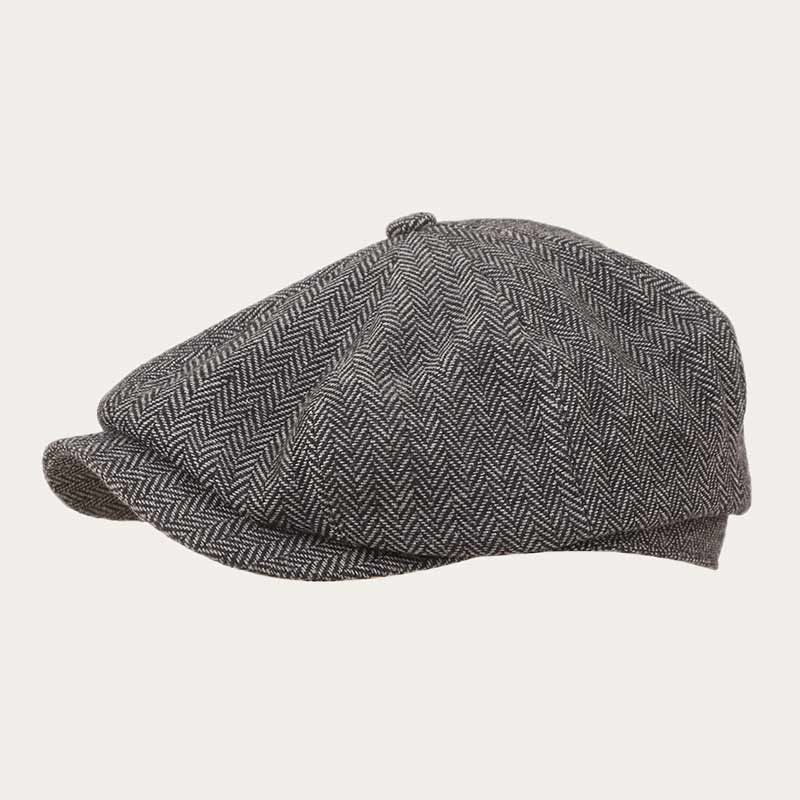 oblique view of grey herringbone newsboy cap