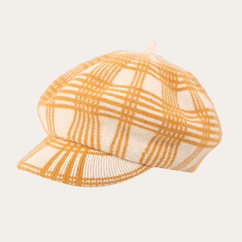oblique view of red pinstriped womens crochet newsboy hat