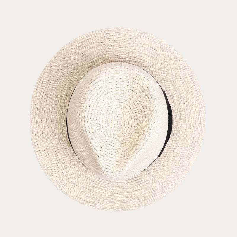 top view of ladies white wide brim straw fedora hat with black ribbon