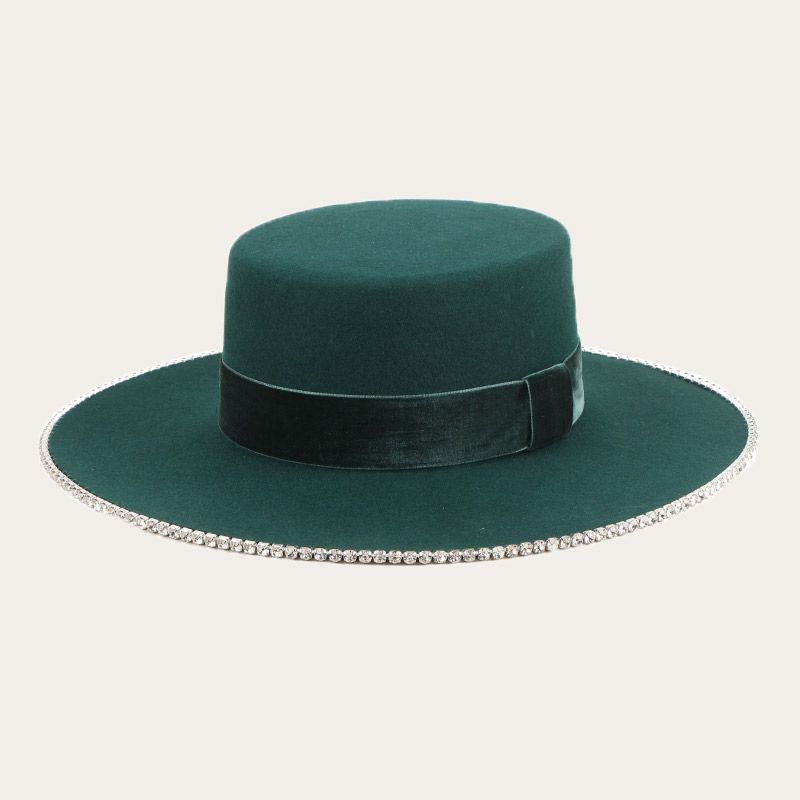 oblique view of green wide brim boater hat with orange wide hatband