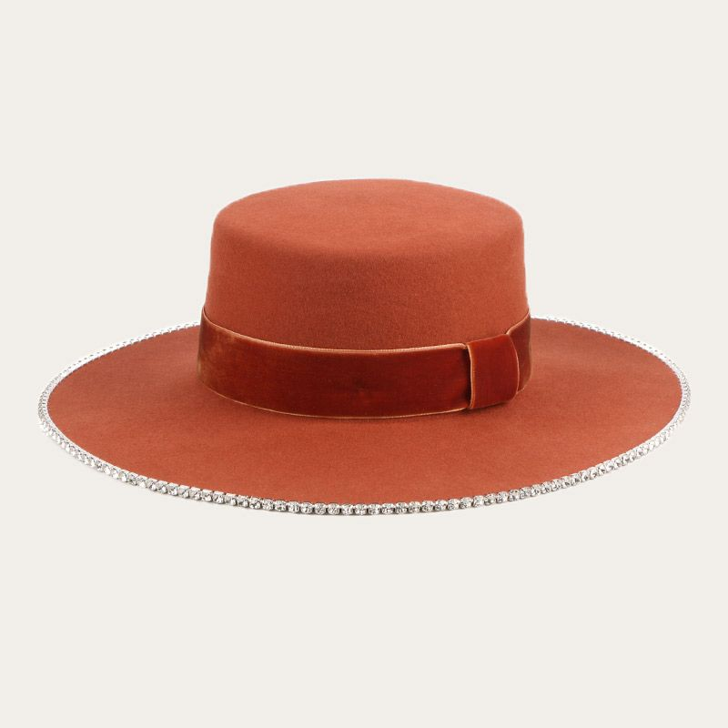 oblique view of orange wide brim boater hat with orange wide hatband